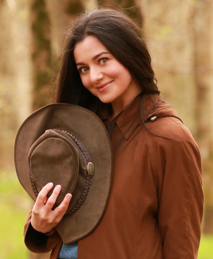 Lady holding cowboy hat